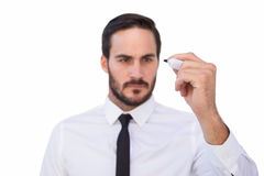 Focused businessman writing with marker Stock Photos