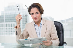 Focused businesswoman holding newspaper Stock Photography