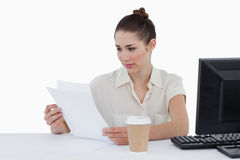 Focused businesswoman looking a document Royalty Free Stock Images