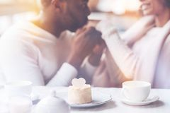 Focused on cake photo expressing tenderness stock photography