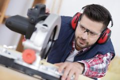 Focused carpenter at work stock photo