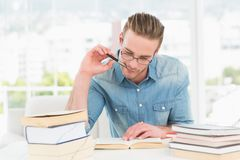 Focused casual businessman studying at his desk Stock Images