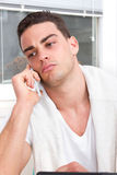 Focused casual handsome man talking on mobile stock photo