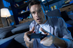 Focused charismatic man obsessed with video games Royalty Free Stock Photo