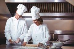 Focused chef preparing a cake Stock Photo