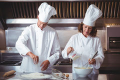 Focused chef preparing a cake Royalty Free Stock Photography