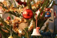 Focused Christmas ball in the Christmas tree. Focus on a red christmas ball in the christmas tree royalty free stock photo