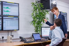 Focused colleagues analyzing result on their computer. In office running diagnostics in large data center stock photos
