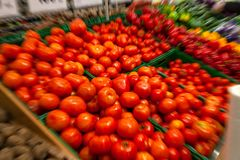 Focused customer choice on red, ripe tomatoes in a supermarket stock photos