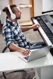 Focused disabled composer working on a new tracks Stock Photos