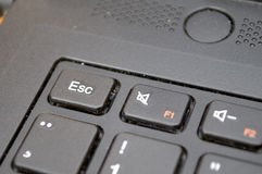 Focused ESC button on a black keyboard stock photo