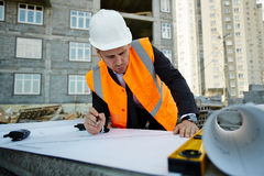 Focused Expert Checking Construction Blueprints Stock Photo