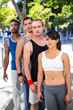 Focused extreme athletes standing in a row royalty free stock photography