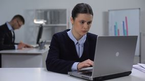 Focused female manager working on laptop, texting e-mail to business partners. Stock footage stock footage