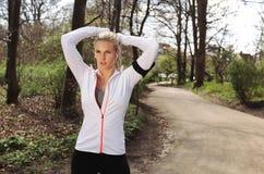 Focused female runner in forest Stock Images