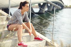 Focused Fitness Woman Resting Stock Photo