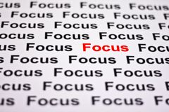 Focused on Focus. Highlighted in red stock photo