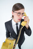 Focused geeky businessman on the phone Stock Image
