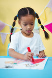 Focused girl colouring her book Stock Photos
