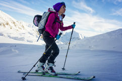 Focused girl on skis Stock Images