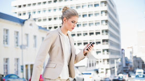 Focused gorgeous businesswoman text messaging Royalty Free Stock Photo