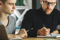 Focused guys doing paperwork Royalty Free Stock Photo