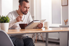 Focused handicapped man having breakfast Stock Images