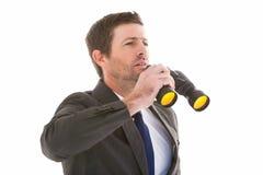 Focused handsome businessman holding binoculars Stock Photos