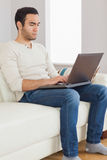 Focused handsome man using his tablet computer Royalty Free Stock Image