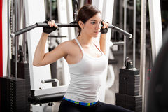 Focused on her gym routine Stock Photography