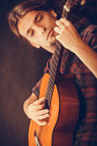 Focused hippie with his guitar. Stock Photography