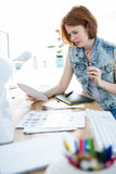 Focused hipster business woman working at her desk Stock Photography