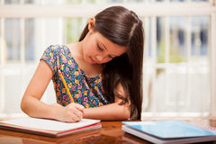 Focused on homework Stock Images