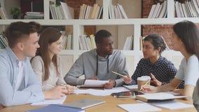 Focused international university friends preparing to college exams.