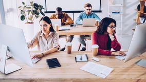 focused interracial young business people working stock photo