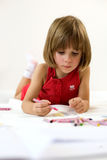 Focused little girl is drawing Stock Photo