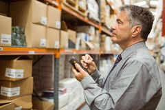 Focused male manager using handheld Stock Photo