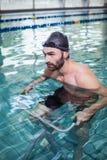 Focused man doing underwater bike Royalty Free Stock Photos