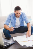 Focused man paying his bills Royalty Free Stock Images