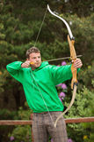 Focused man practicing archery Stock Photos