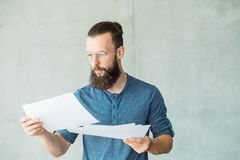 Focused man read business documents information stock image