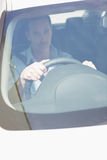 Focused man sitting at the wheel Royalty Free Stock Images