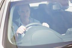 Focused man sitting at the wheel Stock Image