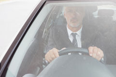 Focused man sitting at the wheel Stock Image