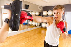 Focused man training boxing at the fitness gym Royalty Free Stock Photography