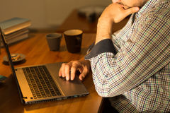 Focused man using laptop Royalty Free Stock Photography