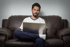 Focused man working hard at home. Stock Images