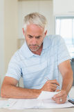 Focused man working out his finances Royalty Free Stock Photography