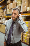 Focused manager talking in a headset Royalty Free Stock Photography