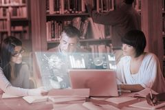 Focused mature students working together on digital interface Royalty Free Stock Photography